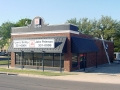 Shingle roofing on a State Farm Insurance office