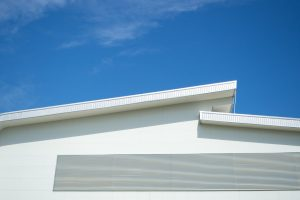 fascia of roof with blue sky