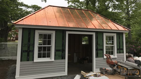 Copper metal roof added to accentuate an entrance